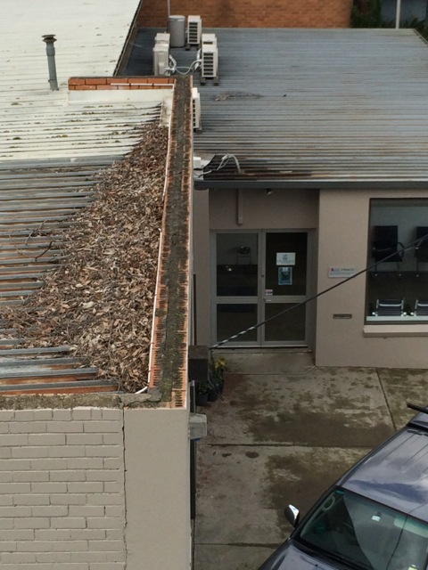 how to clean gutters on high roof